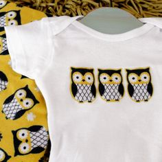 Deck your baby out with original onesie iron-on patterns. Absolutely no sewing involved! Fabric scraps and HeatNBond make this an easy DIY.