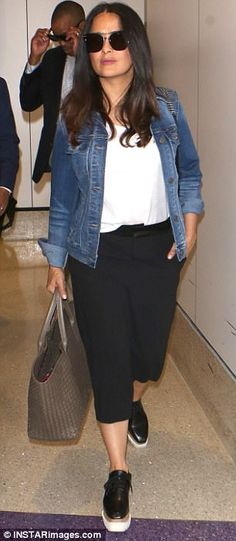 Casual chic: Salma opted for the casual chic look with white T-shirt, denim jacket and bla...