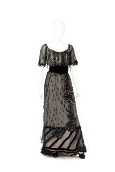 Evening Dress of Irma von Geijer: ca. 1910's, Swedish, silk net covered in sequins, velvet ribbon, velvet waistband, short sleeves in tulle, embroidery.