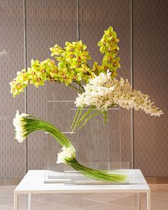 Yellow and white orchids and calla lilies