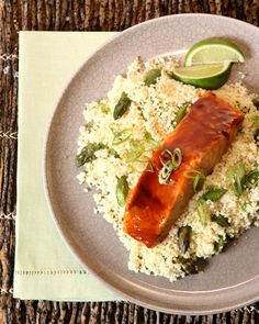 Hoisin-Lime Salmon with Asparagus Couscous. Lime-drizzled broiled salmon gets a sweet-spicy Asian twist from hoisin, a sauce common in Chinese cuisine. Swapping in couscous instead of rice saves time.   Ingredients    2 tablespoons hoisin sauce  2 teaspoons honey  4 center-cut salmon fillets (6 ounces each), about 1 1/2 inches thick  1/2 lime, plus several wedges for garnish  Coarse salt and freshly ground black pepper  Asparagus Couscous  1 scallion, thinly sliced  Nonstick cooking spray