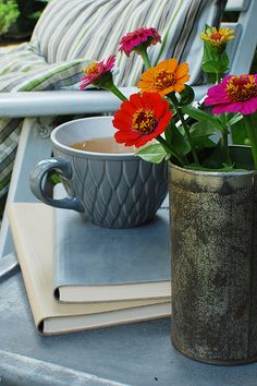 What more could you want?  Books, a cup of tea, bright flowers beside you, tucked in to a comfy chair?
