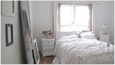 All white bedrooms never get old. I especially love the empty picture frames!