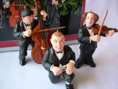 Hallmark Keepsake Ornament - The Three Stooges Musicians 1998 (QX6503) Hallmark,http://www.amazon.com/dp/B002MV6G2Q/ref=cm_sw_r_pi_dp_gj1Lsb19EWMQ5SQR