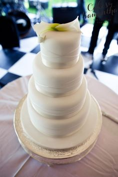 4 tier elegant wedding cake with satin ribbon and cala lilies