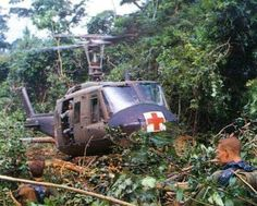 A rescue helicopter takes off from a jungle clearing ~ Vietnam War