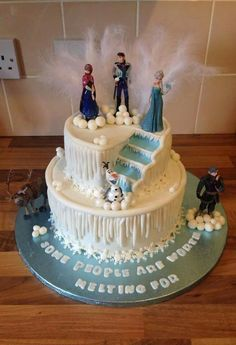 I like some of the elements of this cake: stairs, snowflakes. All of this can be done with frosting instead of fondant though.