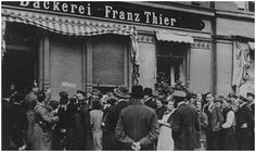 The people of Germany queuing outside a shop before the prices went up.