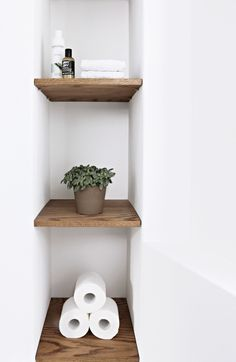 Wooden shelves built into a niche in guest bathroom. Wooden shelves built into a Bathroom Niche, Neutral Bathroom, Bathroom Shelves, Bathrooms, Wooden Shelves, Floating Shelves, Wooden Decor, Basement Remodeling, Toilet Paper