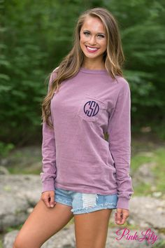 Your true colors are sure to show in this monogram long sleeve pocket tee! From a morning relaxing by the beach to an making s'mores at a bonfire, this tee will be your favorite summer essential!