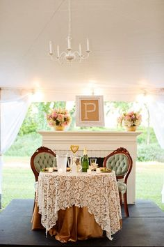 Fireplace behind sweetheart table in barn
