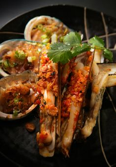 Razor clams cooked on the coconut grill with Hoi An chilli sauce.