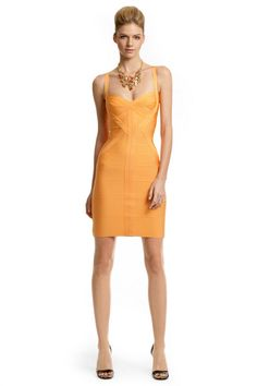Herve Leger  Tangerine Margarita Dress  Something about the color and the material of this dress makes me love it because it can makes anyone look great. Killer curves for everyone. It's like heaven, in a dress form, plus it's length makes it classy.