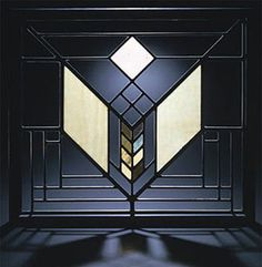 "Art Glass - Lake Geneva Inn / Lake Geneva, WI / 1911 / / Frank Lloyd Wright -- Wright designed the art glass to make a natural transition from te inside and outside. Wright named the ""Tulip"" design because of the flower shape pattern in the center."