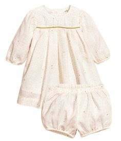 BABY EXCLUSIVE/CONSCIOUS. Set with dress and puff pants in soft, organic cotton fabric. Dress with long puff sleeves with elasticized cuffs, box pleats at top, and buttons at back of neck. Lined. Pants with elasticized waistband and elasticized hems.