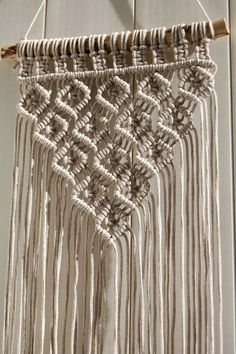 The macrame wall hanging is made of 3 mm cotton cord dusty beige color. It have nice rhomb pattern and looks simple and beautifull! This piece will perfectly fit for boho, scandinavian, rustic, tribal and others interior's concepts! *** Approximately dimensions: Total length : 90 cm