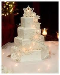 Snowflake cake with lights, snowflakes across the front and looks like fairy lights behind them to light them up. Cool.