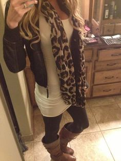 Leather jacket, leapord scarf, long white tank with leggings and brown boots.