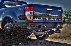 Another view of the new Ford Ranger with a custom rear bumper. New Trucks, Ford Trucks, Pickup Trucks, The New Ford Ranger, Ford Rapter, Ford Ranger Raptor, Cool Cars, Monster Trucks, Bike