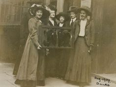Five suffragettes holding a broken window pane with Adela Pankhurst on far left. From 1911 window smashing became an official tactic of the WSPU. Women who took part in this form of campaigning were arrested and took part in confrontational struggles with the police.  http://www.johndclare.net/Women1_WhyViolence.htm