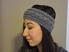 A simple cabled headband with garter stitch borders