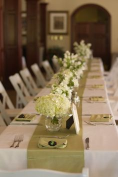 Hydrangea-and-Sage-Table-Runner  Simple white flower centerpieces.