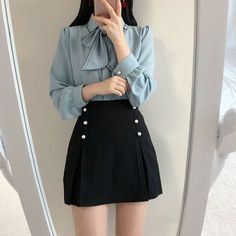 The loose-fitting blouse on top and the structured skirt make a perfect office outfit. The buttons down the side create a uniform effect and juxtapose the feminine top. Kawaii Fashion, Cute Fashion, Skirt Fashion, Fashion Dresses, Fall Fashion, Style Fashion, Korean Fashion Trends, Korea Fashion, Asian Fashion