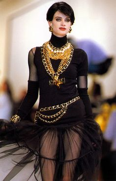 Karl Lagerfields Chanel Hip Hop collection 1991, hip hop was still popular with the large gold chains and bold suits.