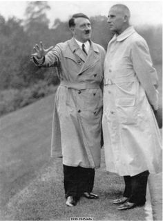 """We shall build . . ."" The Führer with the Reich Minister of the Interior, Dr. Frick, on the site of the Reich Sport Field on October 5th, 1933"
