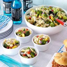 Garden Bow Tie Salad Recipe (contains: cucumber, yellow summer squash, zucchini, sweet red pepper, green pepper, broccoli florets, cauliflower, red onion, Italian salad dressing mix, bow tie pasta, olive oil, red wine vinegar, salt, pepper)