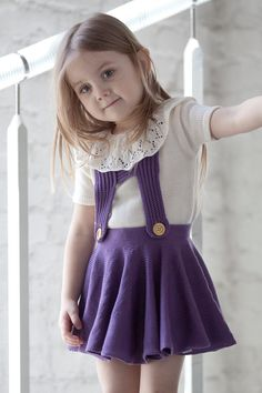 Classic simple knit thick skirt for your little princess! Schoolgirl Skirt has the perfect amount of vintage flair for your little one. Pinafore skirt with suspenders. Waistband is free from elastic for a grown-up feel but the skirt is still adjustable and easy on/off. In front suspenders fastens with wood buttons.  Material: cotton Color in picture: purple If you like to have them from other material our color please choose drop down and choose material and write in notes which color yo...