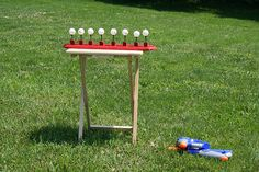 Squirt Gun Game / DIY Carnival Games for Kids (ping pong balls on golf tees or fill empty bottles with sand)