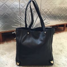 """Perlina leather tote Perlina black leather tote, measures 13"""" X 15"""" X 4"""", back exterior clap pocket. Printed poly silk logo lining w/ back wall zip pocket and key fob. Gold hardware. Missing shoulder strap! #MAKEANOFFERBITCH Perlina Bags"""