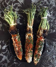 Mexican-Style Roasted Corn by saveur: Char the corn on the grill and then brush it with mayonnaise so that the cheese, cilantro, and chile powder don't fall off! #Corn #Mexican_Roasted_Corn #saveur
