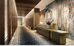 A discreet back building entrance opens onto a modern lobby of marble walls, wood columns and a water feature. Art work chosen especially for the space will ...