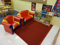 Reading corner: We set up our classroom library near the dramatic corner which allows expansion of play into both areas.