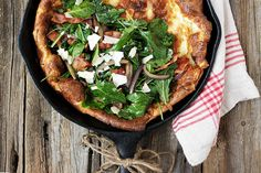 Perfect for leisurely weekend breakfasts, this savory Dutch baby recipe features sauteed kale, red onion and aged cheddar. Great weeknight dinner, as well.