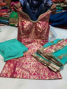 Pink aqua gold suit