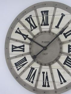 Clock with roman numerals. Need this for my bathroom