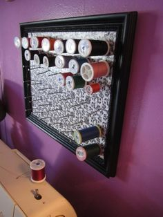 DIY Framed Up Thread Holder  I have done this but remember to put them at a angle up or they come off easy...makes finding the thread you need much easier than going thru a thread box