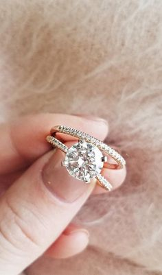 Delicate and beautiful, this diamond engagement ring in 14k yellow gold features a half circle of sparkling petite micropavé diamonds to complement your center diamond.