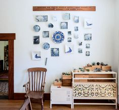 Obsessing over this adjustable wooden picture rail designed by the artist Andre James (as seen in his home, here).