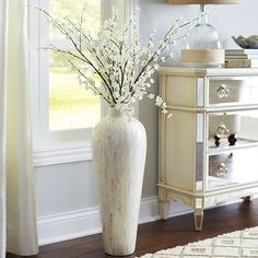 fill a substantial floor vase with a tall arrangement of led