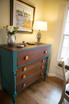 Beautiful vintage dresser for linen storage in a kitchen.