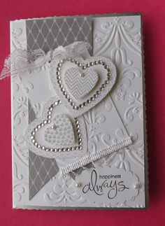 Wedding card, hearts and embossing.