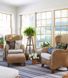 @Vicki Snyder Barn 's sea-grass armchair and ottoman blend interior comfort with outdoorsy charm in this sunroom.