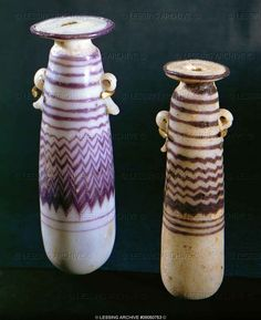 Two elongated decorated vases. Light grey and mauve, two small handles, half round base. From Jerusalem. Glass, Phoenician/Roman Period Height 10.1 cm Inv. H 1600  Reuben and Edith Hecht Collection - University, Haifa, Israel