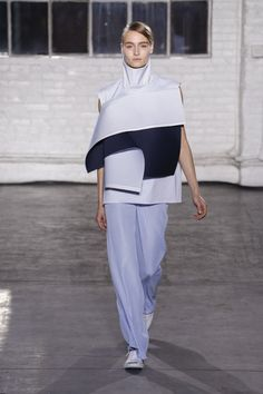 CLAUDIA LI AW15 NYFW. [Angular jutting shapes coming from the chest in an almost shield-like manner.]