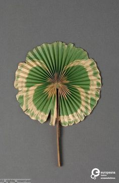 Cockade Floral paper fan by Chambrelent, Paris,1890-1910~Image by MoMu