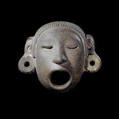 Deity mask (Xipe Totec) made of stone.       Aztec